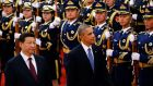 China's President Xi Jinping (left) walks with U.S. President Barack Obama as they inspect the honour guards during a welcoming ceremony at the Great Hall of the People in Beijing. Phhotograph: Petar Kujundzic/Reuters