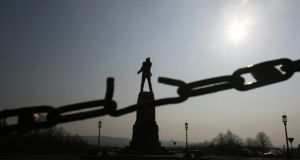 No compromise? The Stormont statue of unionist leader Sir Edward Carson, seen through a broken link, in Belfast. Photograph: Adrian Dennis/AFP/Getty Images