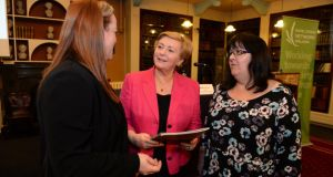 Minister for Justice and Equality Frances Fitzgerald (centre)  with Dr Clíona Saidléar (left) and Anne Scully, both of  Rape Crisis Network Ireland, at theRoyal Irish Academy, Dublin, yesterday. Photograph: Dara Mac Dónaill