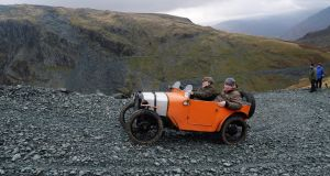 Stewart Gordon drives his Austin 7 Chummy in a vintage car rally stage at the Honister Slate Mine in the Lake District, England.  Photo by Anna Gowthorpe/Getty Images