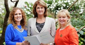 "Carolanne Henry, Vodafone Ireland (left) and Tina Roche, Irish Corporate Leaders on Climate Change,  present the ""Unlocking Opportunities"" report to Tánaiste Joan Burton. Photograph: Mark Maxwell"