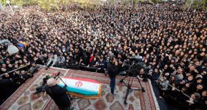 Iranians take part in the funeral of Iranian musician, composer and pop star Morteza Pashaei outside the Vahdat Hall in Tehran today. Photograph: Abedin/Taherkenareh/EPA.