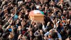 Iranians carry the coffin  of  musician, composer and pop star Morteza Pashaei outside the Vahdat Hall in Tehran today. Photograph:  Abedin/Taherkenareh/EPA.