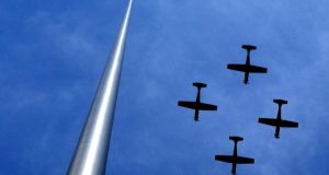 The Air Corps fly past the Millennium Spire during the 1916 Easter Sunday Commemoration Ceremony at the GPO in Dublin  last year. Photograph: Brenda Fitzsimons/The Irish Times.