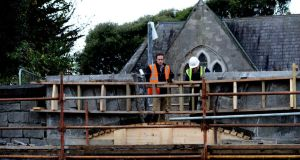 """No building is the same and all have their own challenges"": Stonemason Shane Nolan working on an arch at Grangegorman with Dean O'Hagan. Photograph: Cyril Byrne"