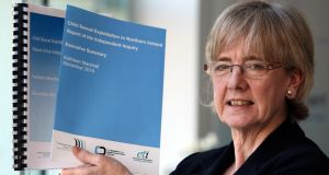 Former Scottish commissioner for children and young people Professor Kathleen Marshall holds her report on child sexual exploitation in Northern Ireland in her office in Belfast. Photograph: PA