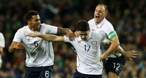Republic of Ireland's Robbie Brady (centre) celebrates with team-mates David Meyler (right) and Cyrus Christie after scoring his side's fourth goal against teh USA. Photograph: Brian Lawless/PA Wire