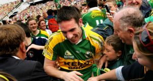 Captain Declan O'Sullivan  is mobbed by adoring fans moments after Kerry won the All Ireland  against Cork 2007. Photograph: Kate Geraghty/Irish Times
