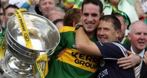 The Kerry manager Jack O'Connor congratulates team captain Declan O'Sullivan after the presentation of the Sam Maguire trophy in Croke Park 2006. Photograph: Irish Times