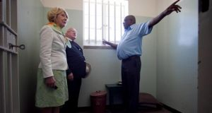 Mr Higgins and his wife Sabina were given a first-hand account of the methods employed by the apartheid government to break and divide inmates on Robben Island by prisoner turned tour guide Thulani Mabaso. Photograph: Chris Bellew / Fennell Photography 2014