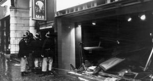 Firemen survey the damage outside the Tavern in the Town pub in Birmingham, after an IRA bomb blast. The firemen quickly counted the injured, deciding they needed 40 ambulances for the tavern alone. But there were no ambulances.  Photograph: Wesley/Keystone/Getty Images