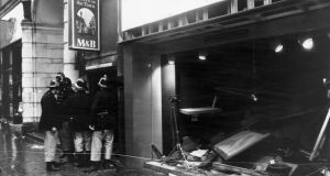 Firemen survey the damage outside the Tavern in the Town pub in Birmingham on November 22nd, 1974,  following an IRA bomb blast. Two bombs exploded; the first in Mulberry Bush at 8.17pm and the second in the Tavern 10 minutes later.   Photograph: Wesley/Keystone/Getty Images