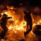 City in flames: Ukrainian anti-government protesters throw Molotov cocktails during clashes with riot police in Kiev in January. Photograph: Dmitry Serebryakov/AFP/Getty