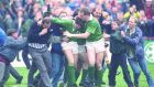 1991: Ireland's Gordon Hamilton  is mobbed after scoring a dramatic late try against  Australia at Lansdowne Road during the Rugby World Cup which was largely based in England.