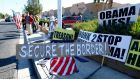 Protesters gather outside Del Sol High School in Las Vegas, Nevada, where US President Barack Obama was scheduled to deliver a speech  on his use of executive authority to relax US immigration policy on Friday night . Photograph: Mike Blake/Reuters