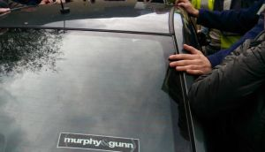A car carrying Tánaiste Joan Burton is seen surrounded by protestors in Tallaght last weekend.