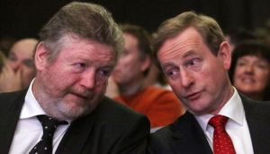 A new poll sees support for Fine Gael fall to 22 per cent . Above, Taoiseach Enda Kenny and Minister for Children James Reilly pictured at an event last week. Photograph: Collins