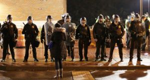 Police line up across from protesters outside the Ferguson Police Department in Ferguson, Missouri. Photograph: EPA