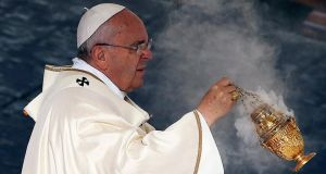 Pope Francis  swings an incense thurible during a canonisation ceremony to elevate six men and women to sainthood,  in St Peter's square at the Vatican on Sunday. Photograph: Alessandro Bianchi/Reuters