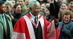 A crowd cheers Nelson Mandela in 2000 as he prepares to be conferred with an honorary degree at Trinity College Dublin. Photograph: Eric Luke