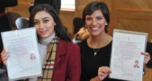 New citizens Mariam Kheshlelashvili from Georgia and Maria Guaman from Ecuador in UCC. Photograph: Daragh Mc Sweeney/Provision