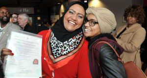 New citizen Mona Elhilall from Sudan with her daughter Dagalla in UCC. Photograph: Daragh Mc Sweeney/Provision