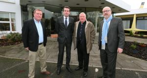 Fr Paddy Byrne, Minister Aodhán Ó Ríordáin,  Monsignor John Byrne and Senator John Whelan at the Montague Hotel direct provision centre. Photograph: Lorraine O'Sullivan