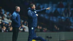 Aston Villa manager Paul Lambert and assistant Roy Keane look on from the touchline during the match at Villa Park. Photograph: Matthew Lewis/Getty Images