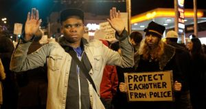 Demonstrators march through the streets of Ferguson, Missouri on November 24th, 2014. Photograph: Jason Redmond/Reuters