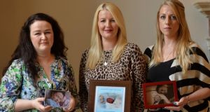 Grace Sharp, Sarah Hynes and Sarah Nugent with pictures of their children Lilly Joy who lived for four hours, Seán who lived for 48 hours and Isabella who lived for 54 days. Photograph: Alan Betson/The Irish Times