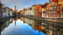 Visit Bruges for chocolate-dominated desserts and lively boat trips