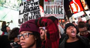People protest in Times Square over the Ferguson grand jury decision to not indict officer Darren Wilson in the Michael Brown case. Photograph: Andrew Burton/Getty Images.