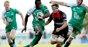 Connacht's Niyi Adeolokun supported by Darragh Leader and Eoin McKeon. Photograph: James Crombie/Inpho