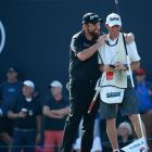 A relieved  Shane Lowry embraces his caddie Dermot Byrne on the 18th green after the finishing his final round of the DP World Tour Championship at Jumeirah Golf Estates  in Dubai, United Arab Emirates. Photograph: Warren Little/Getty Images