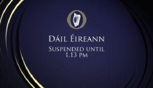 Ceann Comhairle Sean Barrett has suspended the Dáil following a row between Sinn Féinn and Tánaiste Joan Burton.