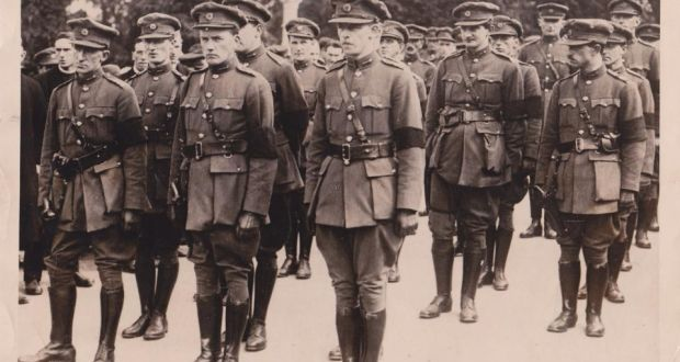 Maj Gen Emmet Dalton, front row, right, at the funeral of Michael Collins with Gen Richard Mulcahy, left, and Adj Gen Gearoid O'Sullivan, middle
