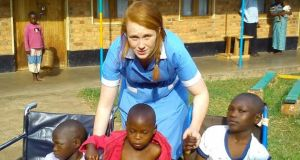 UCD midwifery student Martha Baker-Kenny with children at Kisiizi Hospital, Uganda.