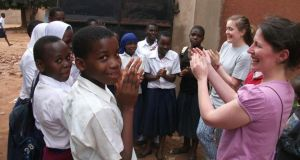 UCDVO volunteer Eleanor Morris with primary school children in Morogoro, Tanzania.