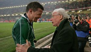 Jack Kyle congratulates Brian O'Driscoll after Ireland's second Grand Slam in 2009. Photograph: Inpho