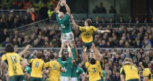 Paul O'Connell wins a line out ahead of Luke Jones of Australia during the game. Photograph: Colm O'Neill/Inpho