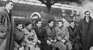 The Irish team, with Jack Kyle third from left, gather at Dublin Station for a Five Nations match against England in 1951. They won 3-0. (From left) James William McKay, William Henry Jordan Millar, Kyle, Richard Rodney Chambers, Noel Joseph Henderson, Desmond McKibbin, James Edward Nelson and John Hartley Smith.Photograph: Fox Photos/Hulton Archive/Getty Images