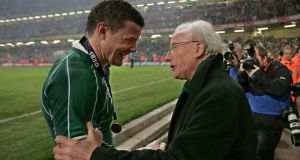 Jack Kyle with captain Brian O'Driscoll after Ireland beat Wales in Cardiff to win their second Grand Slam in 2009, 61 years after the first was inspired by the Belfast man. Photograph: Morgan Treacy/Inpho