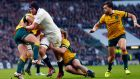 Ben Morgan of England barges towards the Australia line to score a try during the match at Twickenham. Photograph: Andrew Winning/Reuters