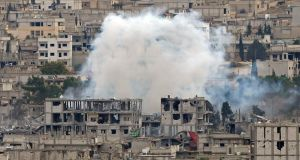 Smoke raises on November 23rd last in  central Kobani, where buildings have been damaged in months of fighting between Islamic State militants and Kurdish forces. File photograph: Osman Orsal/Reuters