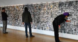 The exhibition 'Man on the Bridge' at the Gallery of Photography, a collection of Arthur Fields' work as he photographed thousands of people passing on O'Connell Bridge from the 30s to the 80s. Photograph: Cyril Byrne/The Irish Times