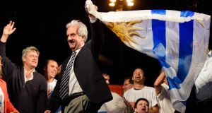 Tabaré Vázquez waves a Uruguayan flag to celebrate his victory in the country's presidential election. His victory follows those in recent weeks for fellow leftists Evo Morales in Bolivia and Dilma Rousseff in Brazil. Photograph: Matilde Campodonico/AP