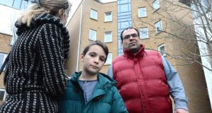 Ventsislava Lyubenova with her son, Angel, and husband Ivaylo Siromashki outside the apartment in Blanchardstown. All their possessions are still inside. Photograph: Cyril Byrne