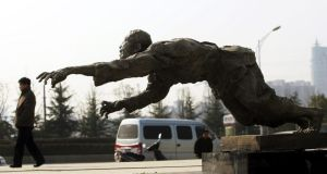 A man walks past a sculpture outside the Memorial Hall of the Victims of the Nanjing Massacre by Japanese Invaders, in Nanjing. Photograph: China Photos/Getty Images
