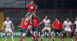 Munster's Billy Holland wins a lineout in the Guinness Pro12  game against Ulster at Thomond Park, where the north and south terrace was closed. Photograph:    Ryan Byrne/Inpho