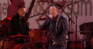 Bruce Springsteen and Coldplay's Chris Martin filled in for U2's injured lead singer Bono at a surprise World AIDS Day concert in New York's Times Square. Video: A (Red) thank you presented by (Bank of America) Red/Reuters